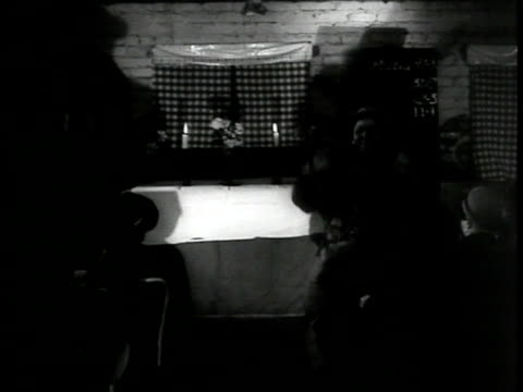 vídeos y material grabado en eventos de stock de spritual meeting in small brick space w/ africanamerican black woman leading seated congregation in gospel music song 'every time i fell the spirit'... - coro