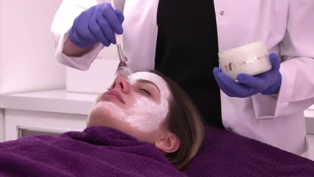 spurred on by the pressure to look good in social media selfies young albanian women are being lured by low price offers from beauty salons that... - plastic surgery stock videos & royalty-free footage
