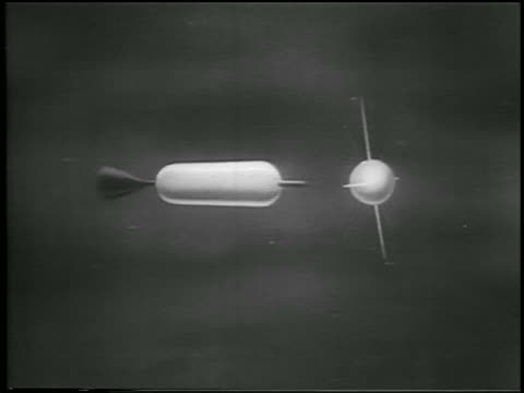vídeos y material grabado en eventos de stock de sputnik 2 space capsule separates from booster rocket in space / newsreel - 1957