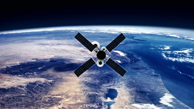 spy satellite orbiting earth. nasa public domain imagery - aerospace stock videos & royalty-free footage