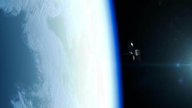 spy satellite orbiting earth. - orbiting stock videos and b-roll footage