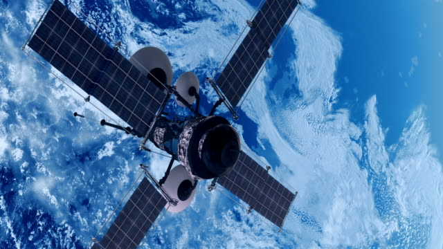 spy satellite orbiting earth - satellite video stock e b–roll