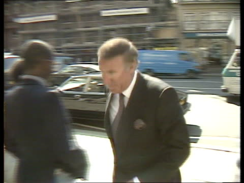 stockvideo's en b-roll-footage met 'spycather' publication newspapers fined **** for england london andrew neil out of car amp into court andreas whittam smith into high court - andrew neil