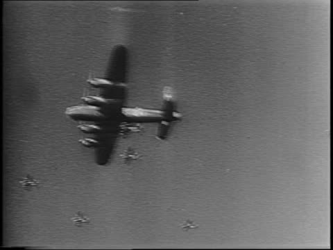 squad of bomber planes flying / bird's eye view of explosions caused by bomber plane attack. - allied forces stock videos & royalty-free footage