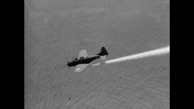 Squad of US single engine fighter airplanes diving / WS Airplane diving laying smoke screen over waters / XWS Airplanes flying through smoke screen...