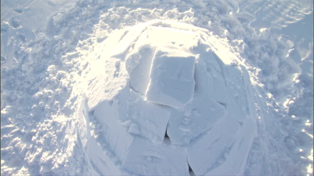 square blocks of snow form an igloo. available in hd. - igloo stock videos & royalty-free footage