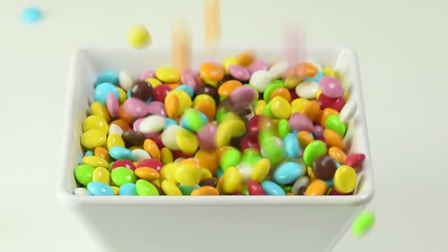 square bowl with smarties topping for ice cream - frozen yogurt stock videos and b-roll footage