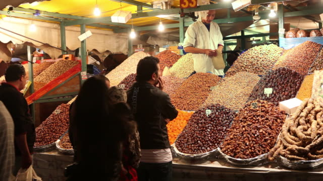 square called djemaa el fna at dusk. food and fruit stalls, marrakech, morocco - nut food stock videos & royalty-free footage