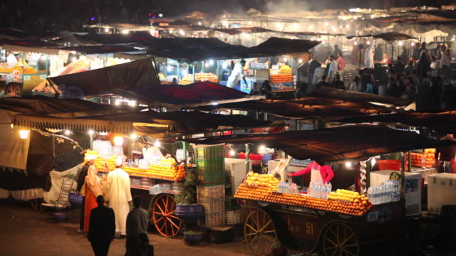 Square called Djemaa El Fna at night. Food and fruit stalls, Marrakech, Morocco