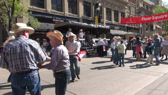 ms square dance for over sixty years people on street of calgary / calgary, alberta, canada - traditional ceremony stock videos and b-roll footage