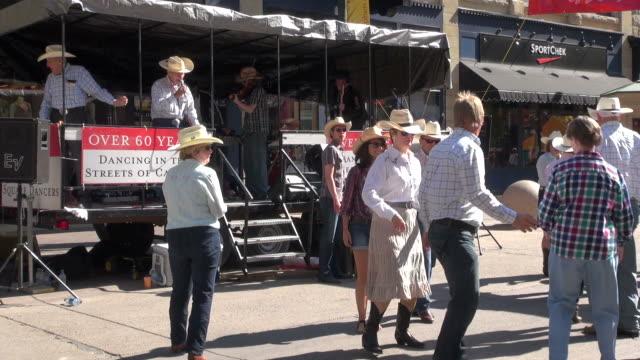 vídeos de stock e filmes b-roll de ms square dance for over sixty years people on street of calgary / calgary, alberta, canada - dança quadrada