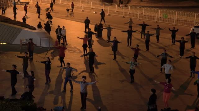 WS Square dancing at night, Chaoyangmen South Street, Beijing, China