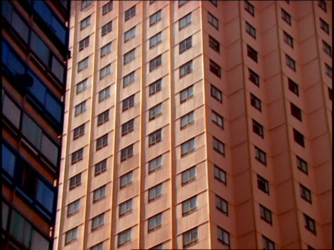 square windows dot an apartment building in mexico. - fensterfront stock-videos und b-roll-filmmaterial