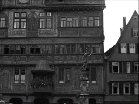 1935 b/w ws pan tu square with town hall and fountain / tubingen, baden-wurttemberg, germany - 1935 stock videos & royalty-free footage