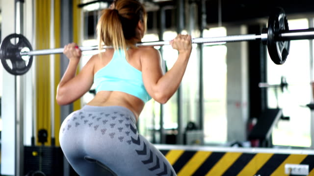 squat training. - brightly lit video stock e b–roll