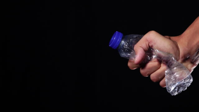 環境問題のためのスクイーズボトルコンセプト - 潰された点の映像素材/bロール