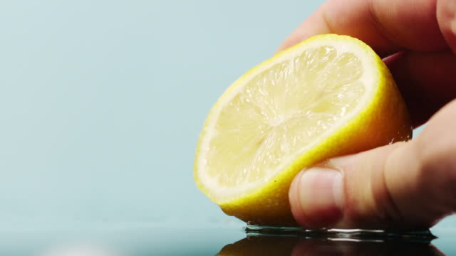 squeezing a lemon - lemon stock videos & royalty-free footage