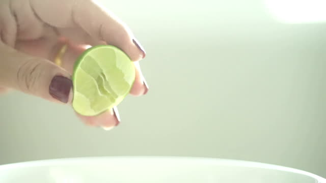 squeezing a piece of lime - lime stock videos and b-roll footage