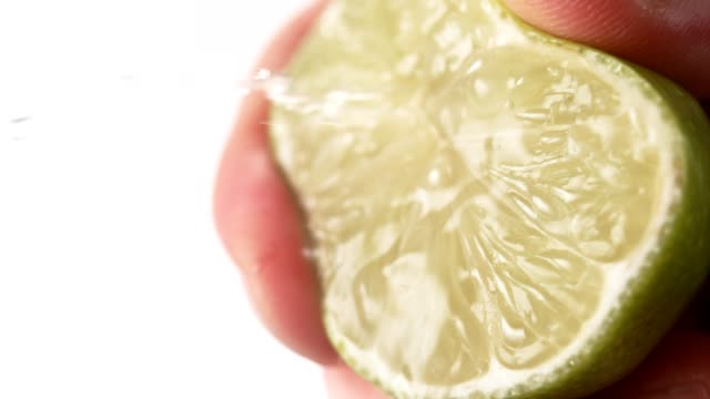 squeezing lime - ascorbic acid stock videos & royalty-free footage