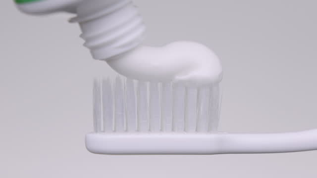 squeezing toothpaste on toothbrush - brushing stock videos & royalty-free footage