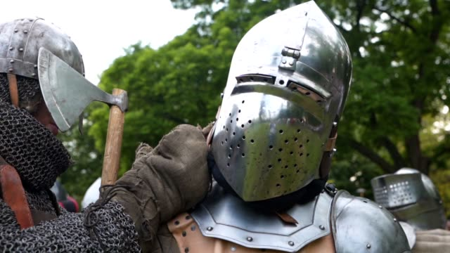 a squire helping a knight with his armor - knight person stock videos & royalty-free footage