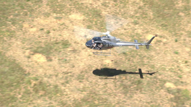 B2 squirrel Helicopter flying low over South African plains