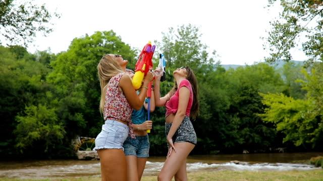 squirt guns fights - squirt gun stock videos and b-roll footage