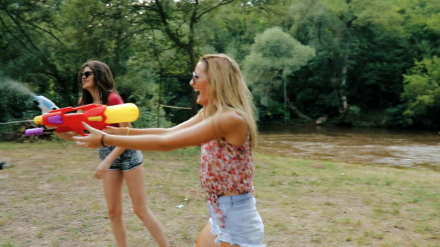 squirt guns fights - small group of people stock videos & royalty-free footage