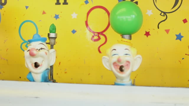 squirt water into the clowns mouth game at an arcade - toy stock videos & royalty-free footage