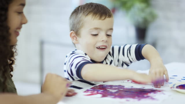 squishing paint - finger painting stock videos and b-roll footage