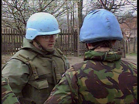 UN convoy halted BOSNIA Kalesija FORWARD past halted UN convoy consisting of armoured trucks lorries and jeeps CMS SIDE UN armoured truck RL and...