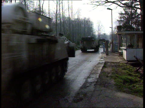 stockvideo's en b-roll-footage met srebrenica convoy/munitions haul tuzla airport ms canadian apcs along la cms canadian un soldier in apc's turret as along pan bv apcs along road away... - munitie