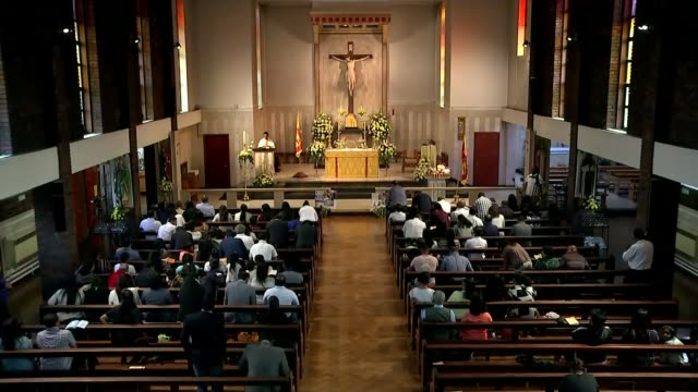 7 of the 8 british victims named england london brent willesden green st mary magdalen rc church int wide shot church service in progress... - gottesdienst stock-videos und b-roll-filmmaterial