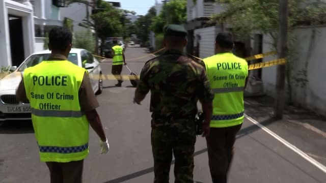 Prime Minister says identity of bombers being investigated Sri Lanka Western Province Colombo GVs / crime scene at residence of two suspected bombers...