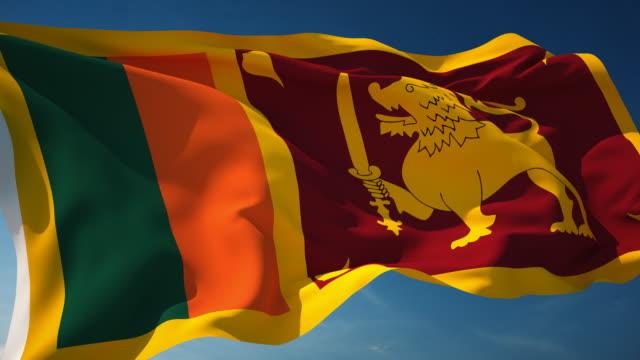 4k sri lanka flag - loopable - sri lankan flag stock videos & royalty-free footage