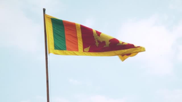 sri lanka national flag with blue sky - sri lankan culture stock videos & royalty-free footage