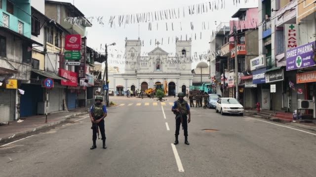 a sri lankan navy seaman guards a road near st anthony's shrine on april 27 2019 in colombo sri lanka more than 253 people were killed on easter... - sri lanka stock videos and b-roll footage