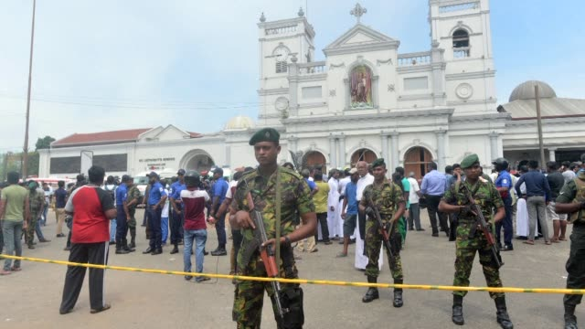 sri lankan security personnel gather outside st. anthony's shrine in kochchikade following an explosion - sri lanka stock videos & royalty-free footage