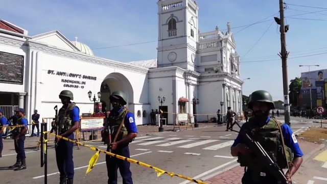 sri lankan security personnel stand guard on monday near an area where police try to defuse a bomb found near the historic st anthony's shrine one of... - sri lanka stock videos & royalty-free footage