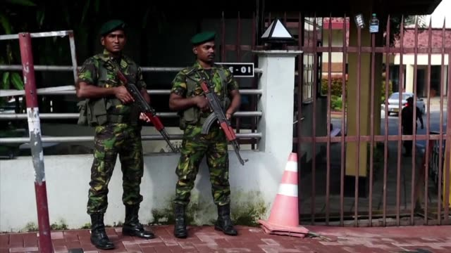 sri lankan soldiers stand guard in front of state run television station in colombo a day after the country's former president mahinda rajapakse was... - prime minister stock videos & royalty-free footage