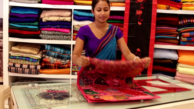 sri lankan woman in a sari as a shop assistant - sari stock videos and b-roll footage