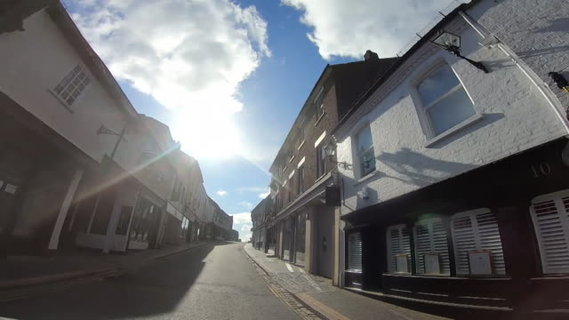 st albans high street with all shops closed due to the coronavirus lockdown - ハートフォードシャー点の映像素材/bロール