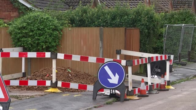 general views england hertfordshire st albans ext fence with sign 'danger keep out' around sinkhole in street / parked lorry / barriers in road /... - keep out sign stock videos & royalty-free footage