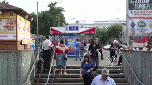 St Andrews Church sits on the skyline in Kiev Ukraine on Thursday May 29 Street buskers sing and play an accordian outside a subway station Commuters...