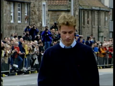 st andrews: lms prince charles and prince william towards in fronts of crowds of people gathered to see william start university lib england:... - prince edward, earl of wessex stock videos & royalty-free footage