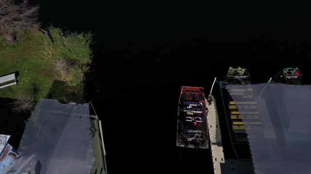 st. augustine, fl, u.s. - drone views of airboat moving among reeds at alligators wildlife territories, on monday, january 6, 2020. - named wilderness area stock videos & royalty-free footage