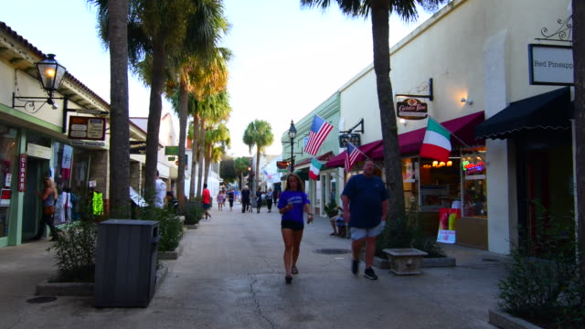 St Augustine Florida oldest city in nation people walking on St George Street with shops and restaurants tourists 4K,