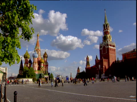 st. basil's cathedral and saviour tower in red square under blue sky and fluffy clouds moscow - st. basil's cathedral stock videos and b-roll footage