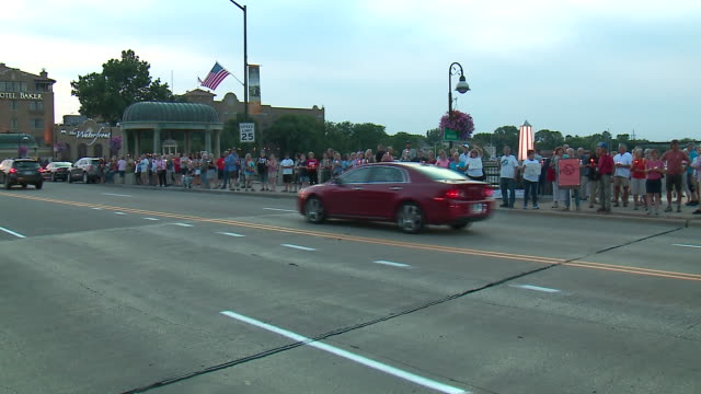 wgn st charles il us crowd gathered along fox river at memorial vigil after mass shootings in el paso and dayton on monday august 5 2019 - votive candle stock videos and b-roll footage