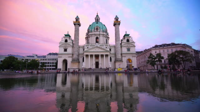 st. charles's church in vienna at sunset - vienna austria stock videos & royalty-free footage